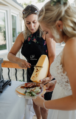 The bride is being served raclette first