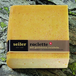 Raclette cheese with roasted onions from cheese maker Seiler