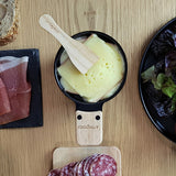 raclette cheese in LUMI raclette melter
