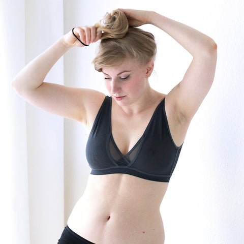 eco lingerie blogger wearing small back and large cup wireless bra with support for big boobs