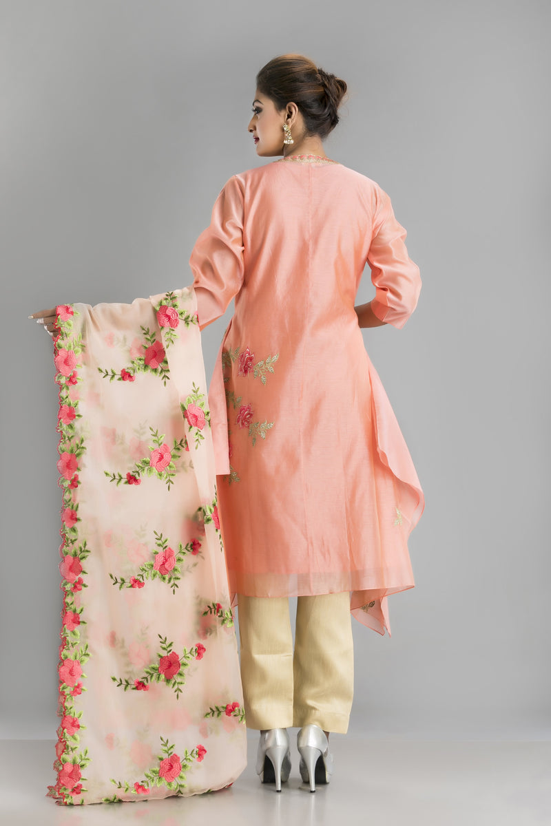 Bahaar-A subtle peach suit for a summery morning