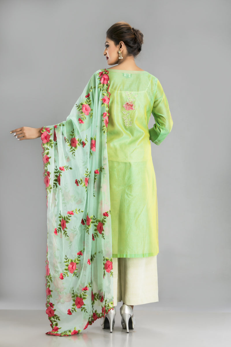 Bahaar-A Chanderi silk suit in pista green for a spring ready look
