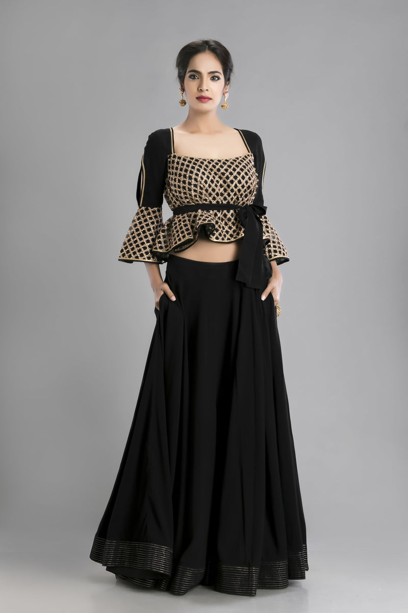 Aatish-for a nocturnal rendezvous. A crepe skirt with cutaway cold shoulders