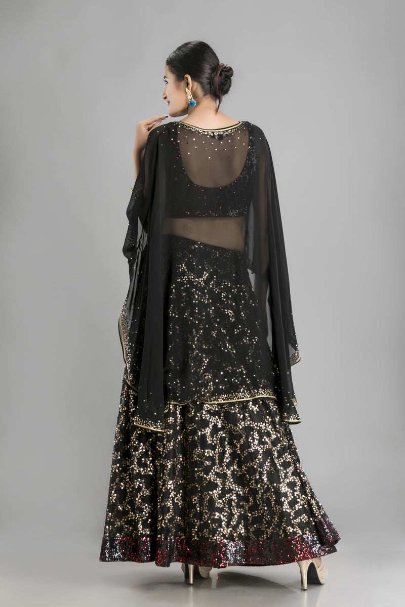 The Kohl Black Lehenga and Cape-Sparkle that special evening need