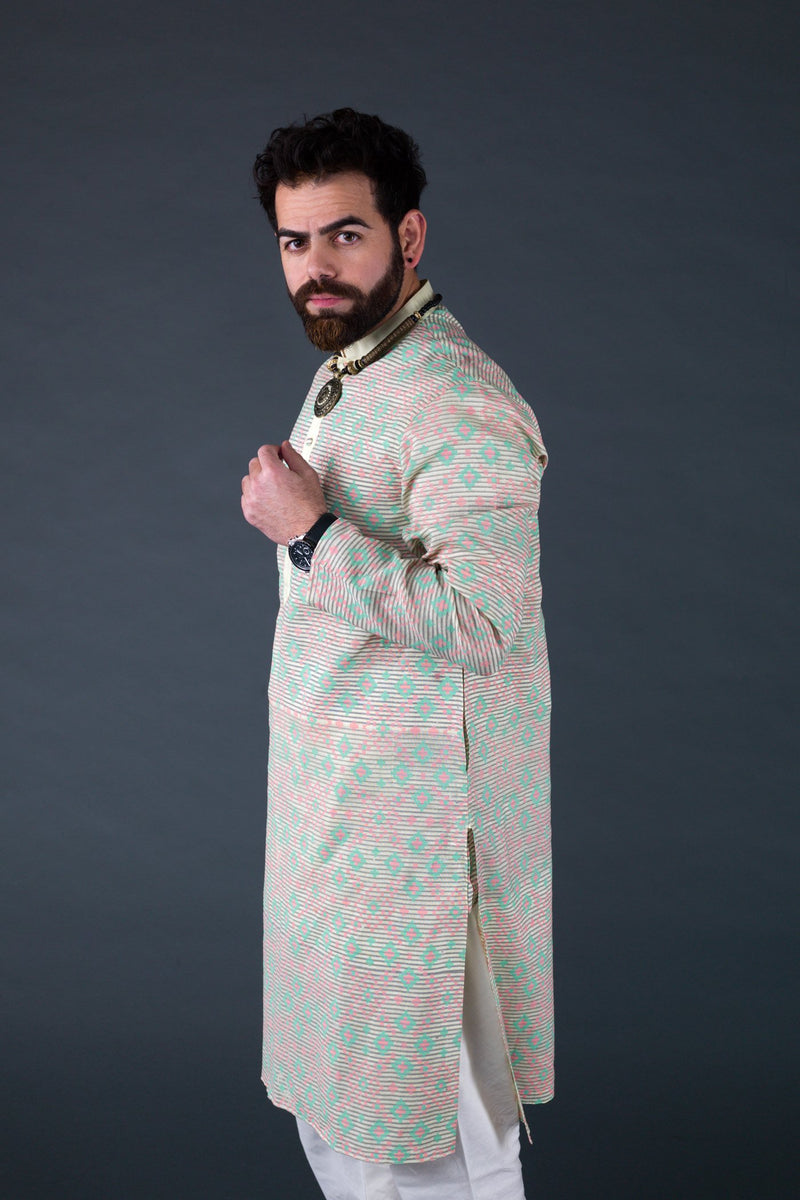 Yellow linen block printed kurta with off white cotton silk churidaar