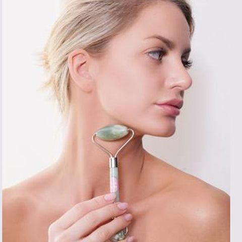 Use this stone face roller to de-puff and glow your skin.