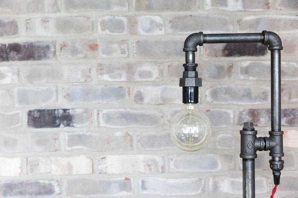 A background scene of bricks and an industrial pipe lamp