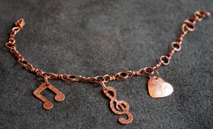 """For The Love of Music"" Copper Music Note Charm Bracelet"