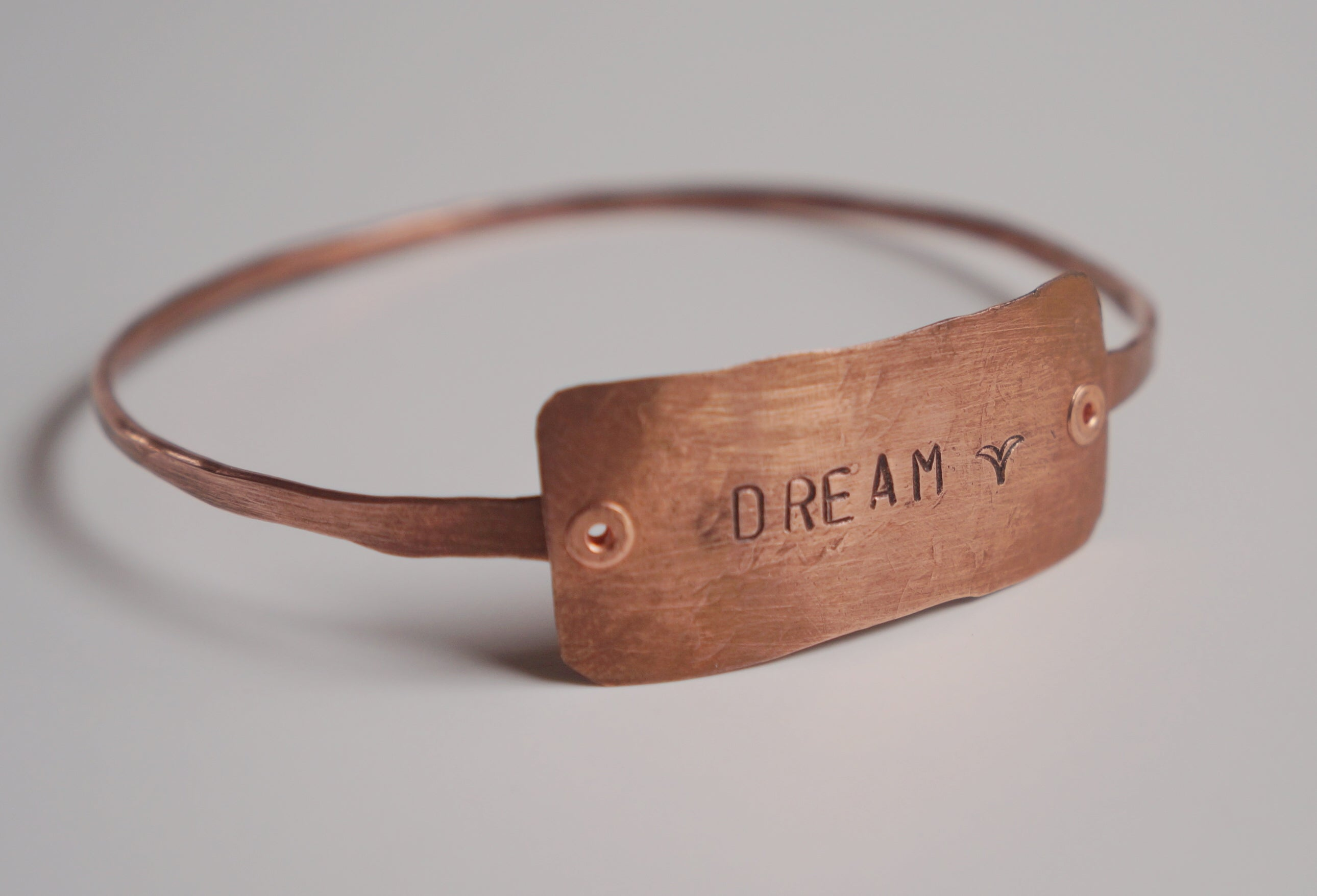 "Hammered and stamped copper ""Dream"" bangle bracelet"