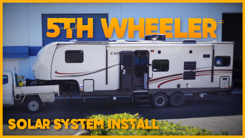 Image if a long 5th wheeler caravan parked outside the SolarNSat Workshop after a solar install.