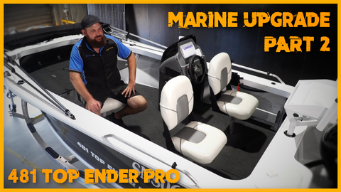 Adam Duck sitting on a white chair on a top ender pro boat in the workshop