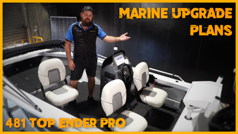 Adam Duck standing on a black and white 481 top ender pro boat for fishing
