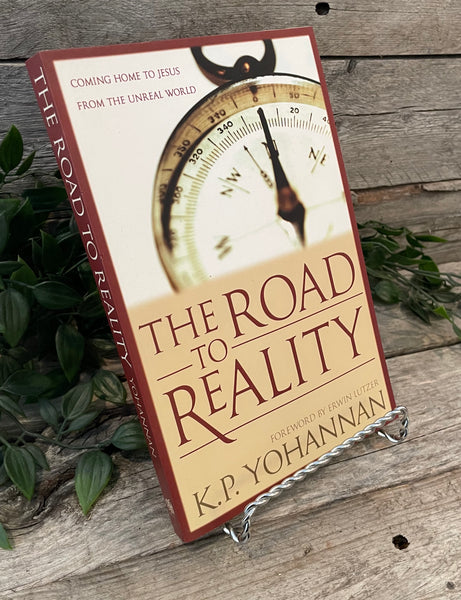 """The Road to Reality: Coming Home to Jesus From The Unreal World"" by K.P. Yohannan"