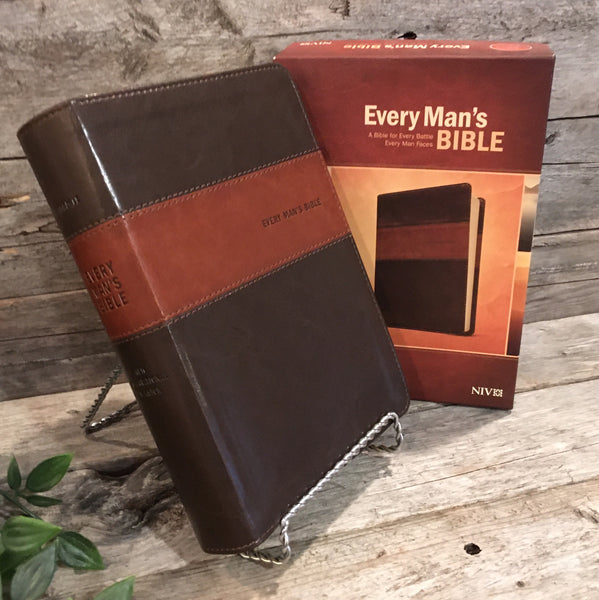 "Every Man's Bible: A Bible For Every Battle Every Man Faces (Deluxe Heritage Edition; NIV)"" by Tyndale"