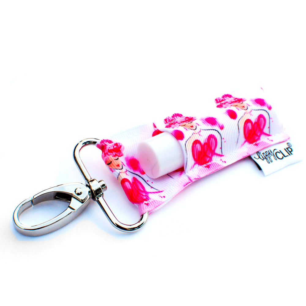 LippyClip Lip Balm Holder with silver clip, white background with hand-drawn woman in pink