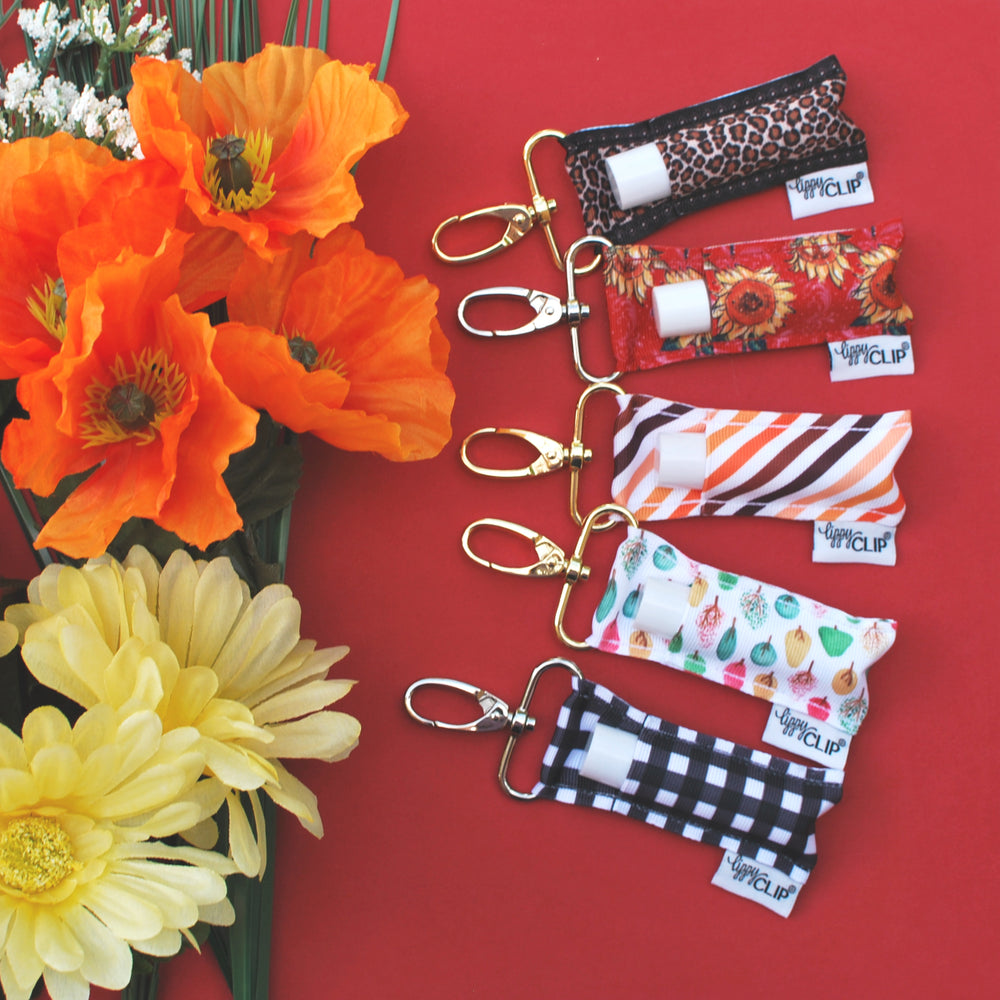 Fall LippyClip collection on red background with flowers