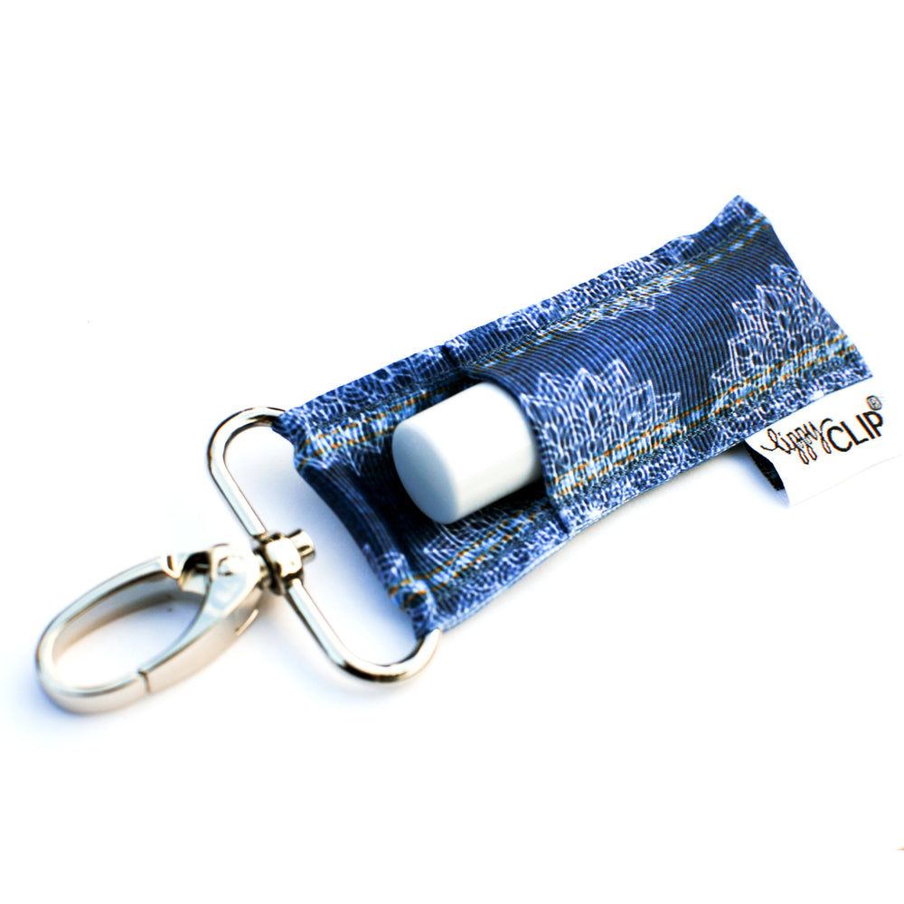 LippyClip Lip Balm Holder with silver clip, denim background with white printed lace