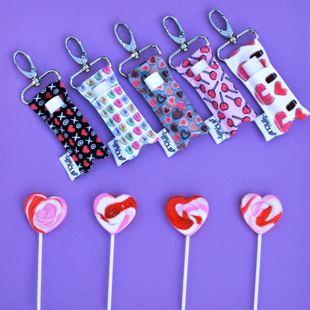 Valentine's Day LippyClip Collection on purple background with heart lollipops