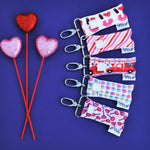 Valentine's Day LippyClip Collection on dark purple background with red and pink hearts