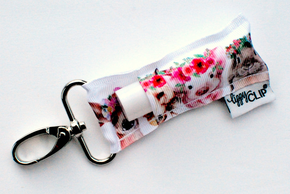 LippyClip Lip Balm Holder with silver clip, white background with farm animals wearing pink flower crowns