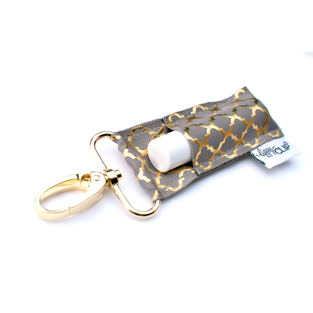 LippyClip Lip Balm Holder with silver clip, grey background with gold quatrefoil pattern