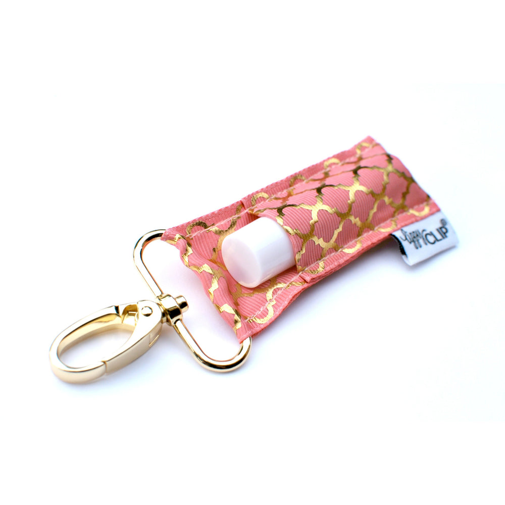 LippyClip Lip Balm Holder with gold clip, coral background with gold quatrefoil