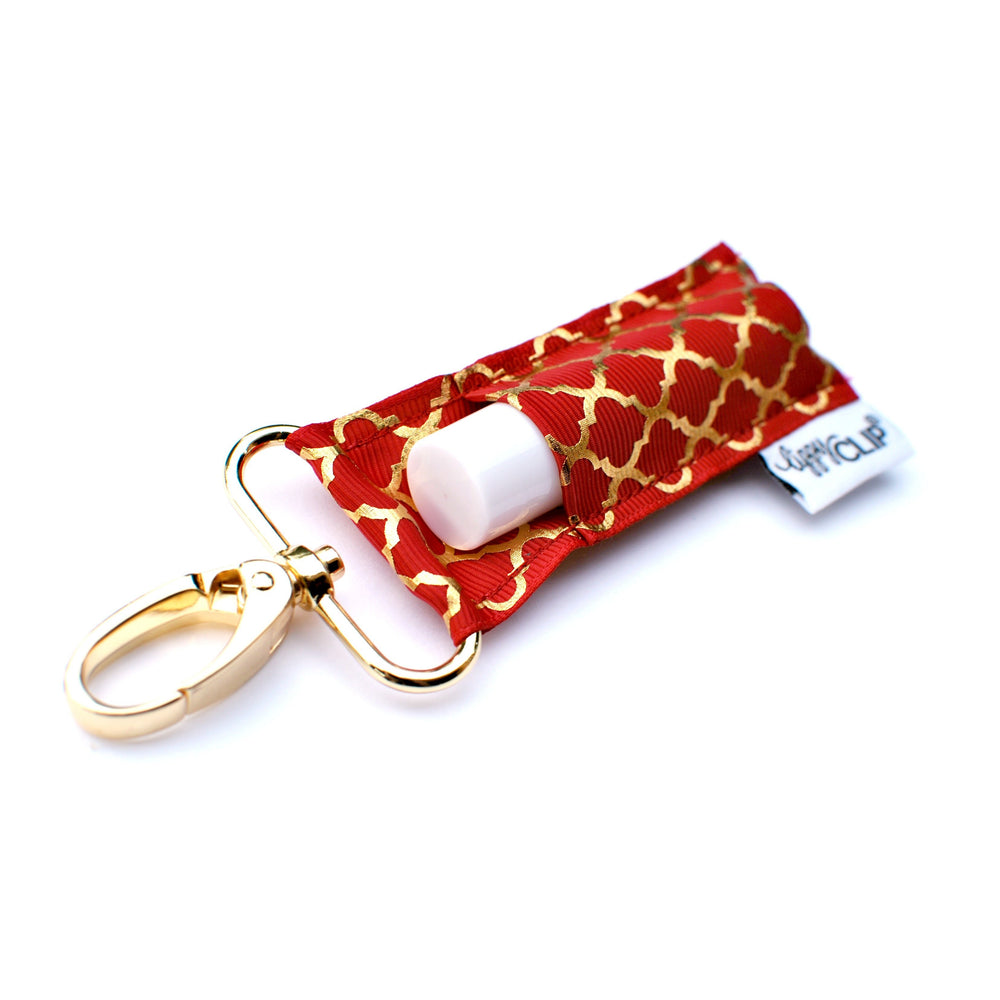 LippyClip Lip Balm Holder with gold clip, cranberry background with gold quatrefoil