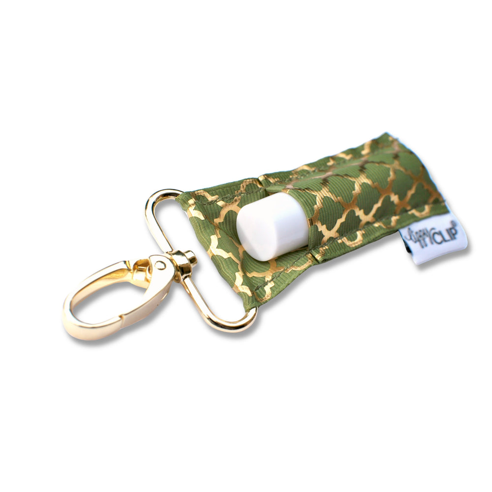 LippyClip Lip Balm Holder with gold clip, olive green background with gold quatrefoil pattern