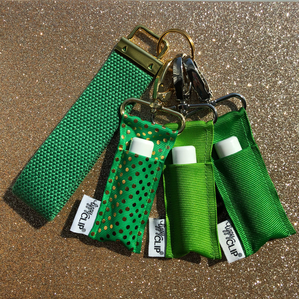 Trio of three green LippyClips attached to keyring with strap.