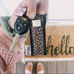 Woman holding keys with Leopard LippyClip at front door