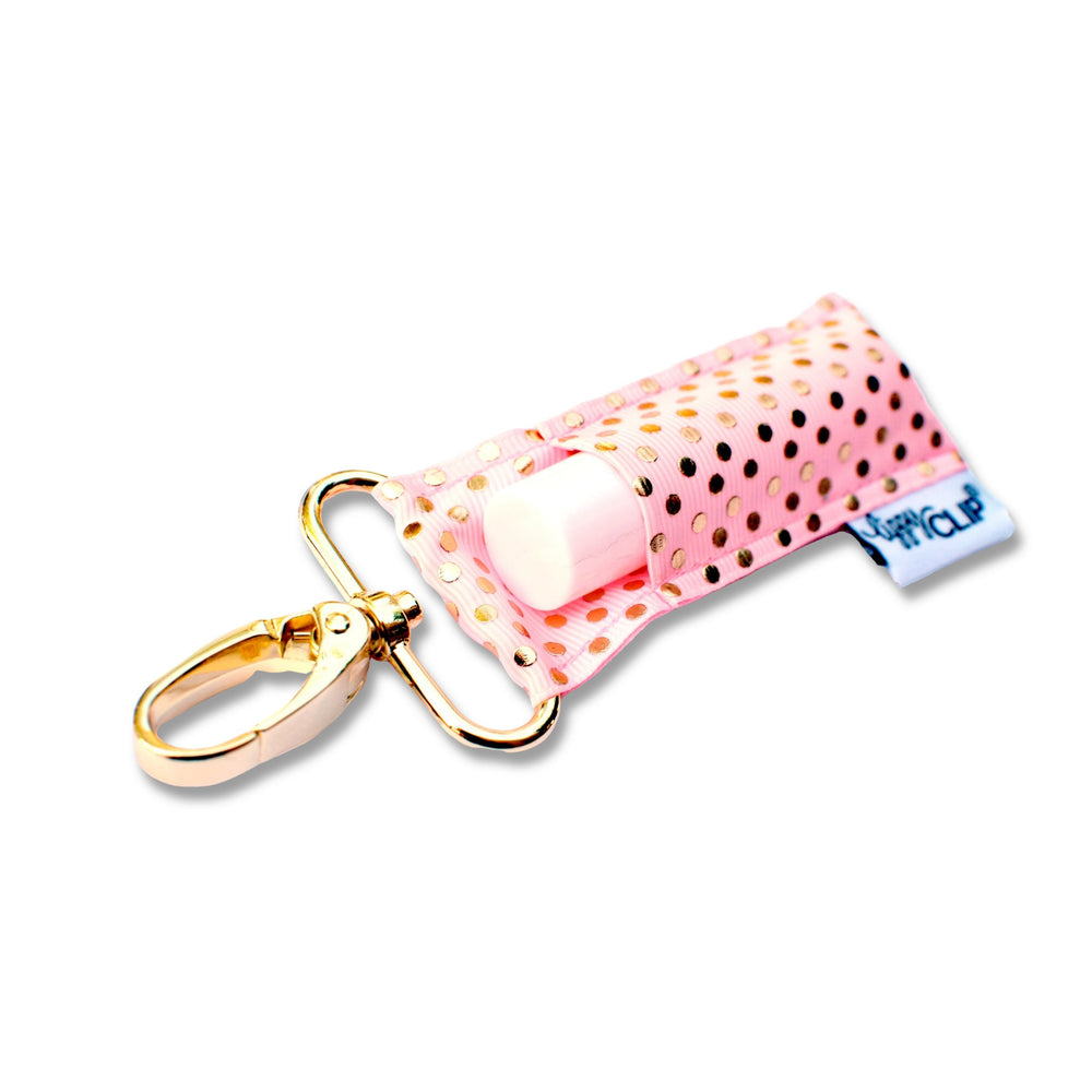 LippyClip Lip Balm Holder with gold clip, light pink background with gold polka dots
