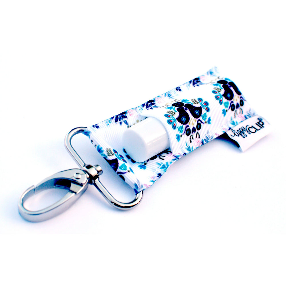 LippyClip Lip Balm Holder with silver clip, white background with blue love birds and floral
