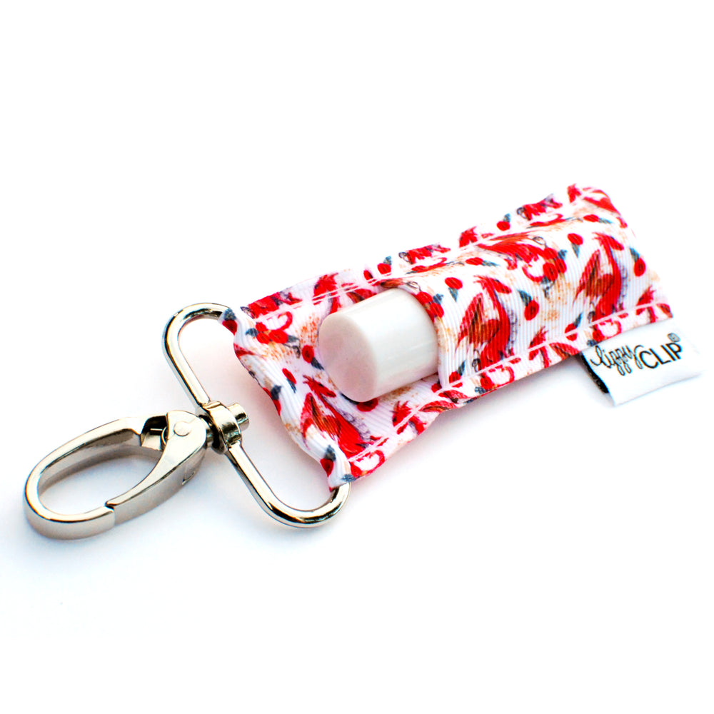 LippyClip Lip Balm Holder with silver clip, white background with red dragons