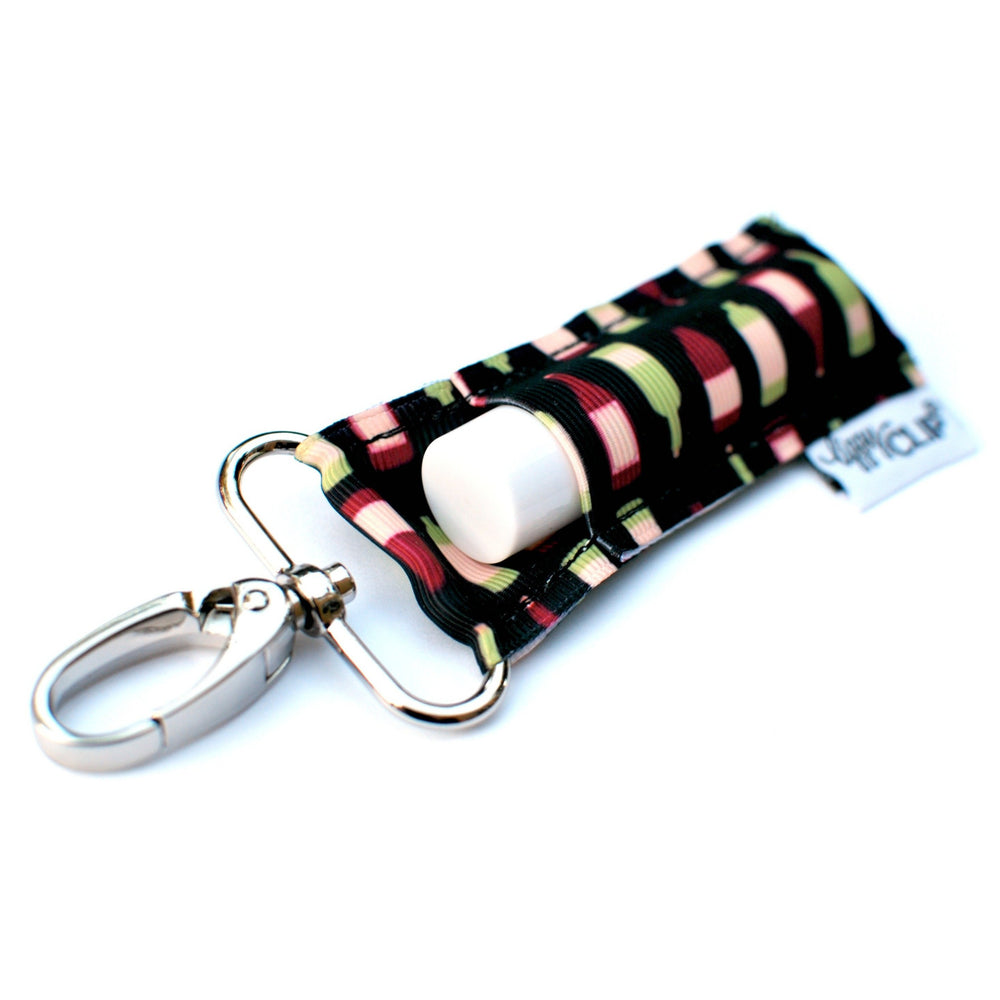 LippyClip Lip Balm Holder with silver clip, black background with green and cranberry wine bottles