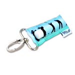 LippyClip Lip Balm Holder with silver clip, blue and green background with silhouettes of men golfing