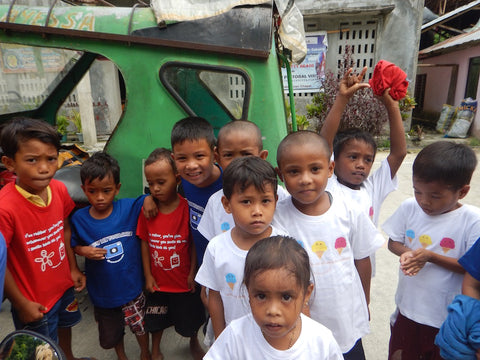 Spread more smiles donated tee shirts to young children living in parts of Siargao.