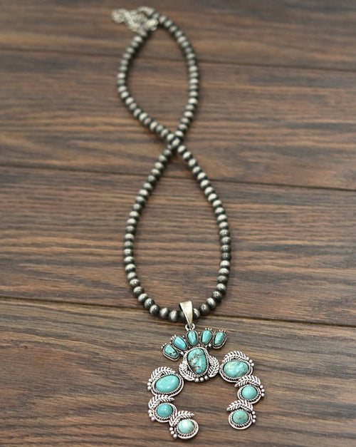 Turquoise Squash Blossom on Western Pearl Necklace