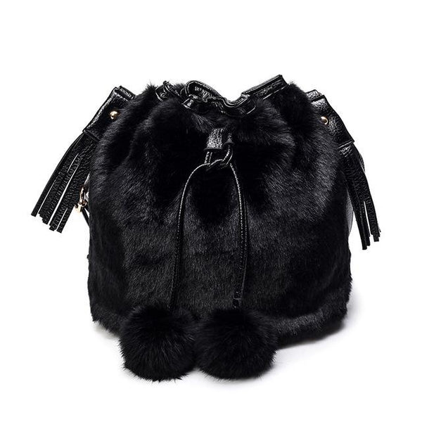 women fur handbag with fur balls and tassels black