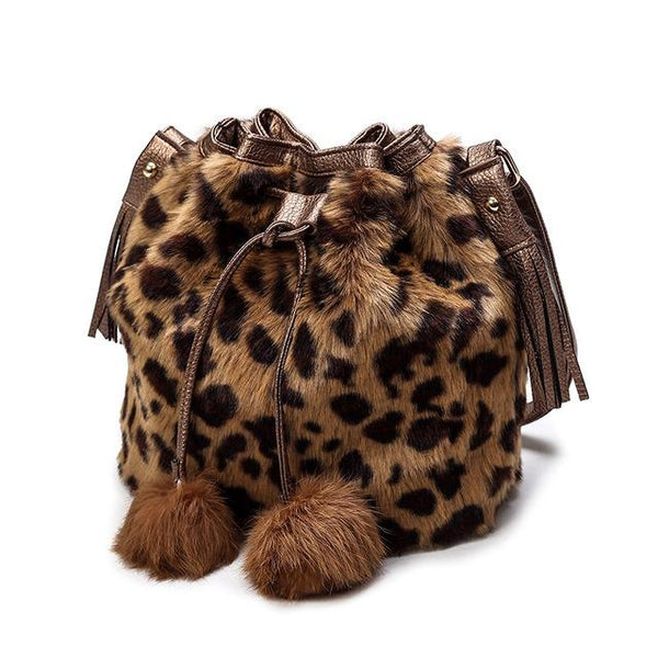 women fur hand bag with fur balls leopard