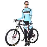 Women riding a bycile wearing a cycling suit in Light blue colour
