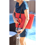Woman with PortoVino Wine Purse (Red)