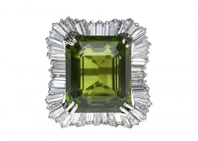 This stunning 1950's peridot cocktail ring also features approximately 5ct of diamond!