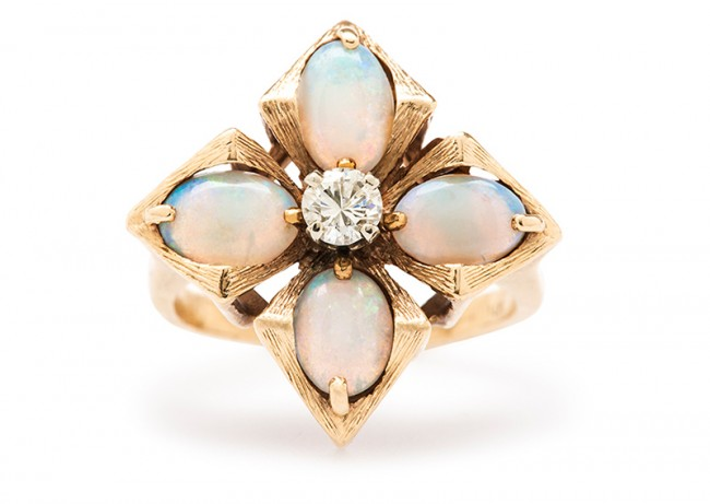 Mayflower is a beautifully designed 1960's yellow gold, opal and diamond cocktail ring.