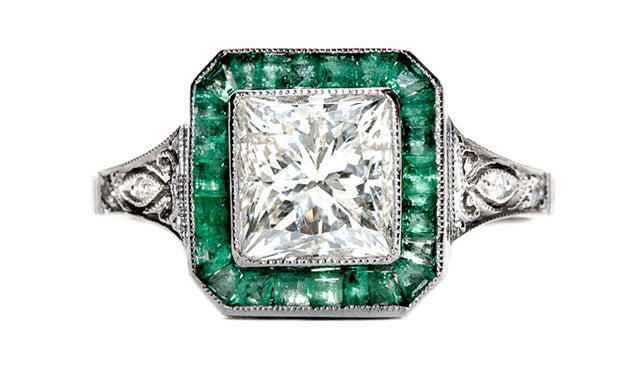 vintage inspired emerald diamond halo ring