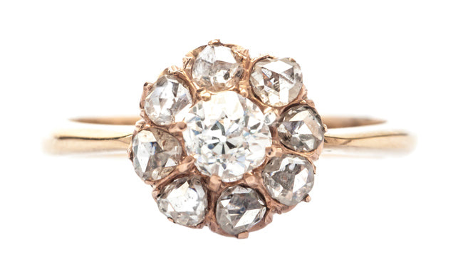 Pimsbury is a lovely Rose Gold Victorian era diamond cluster ring featuring Old Mine Cut diamonds.