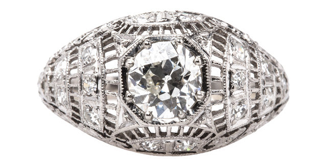 Byron Bay is an intricately designed Edwardian era engagement ring centering an Old European Cut diamond.