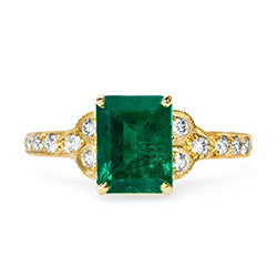 gold ring with rectangular emerald
