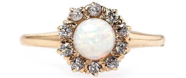 Ravenscourt is a sweet Victorian era opal engagement ring with a halo of Old Mine Cut diamonds.