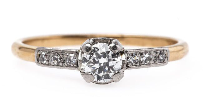Battle Creek is a gorgeous and delicate Edwardian era engagement ring with an Old European Cut diamond center.