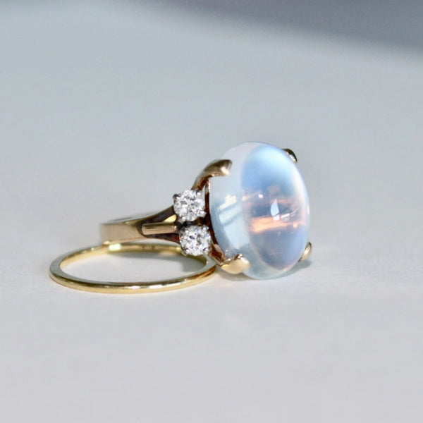 Stillson is a dream retro era and diamond ring set in 14k yellow gold featuring a cabochon moonstone.